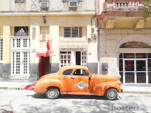A classic car outside Wanda's Cafe/Bar in Havana.