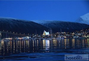 Tromsø at dusk with the Arctic Cathedral in the foreground