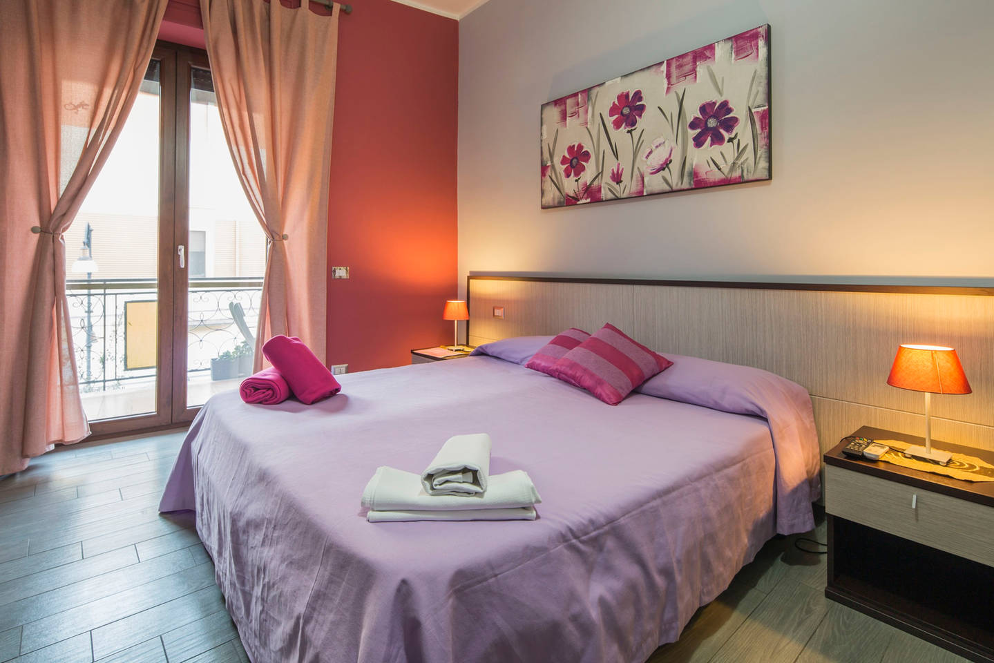 Bed and Breakfast Eco Pompei, quadruple pink room with balcony.