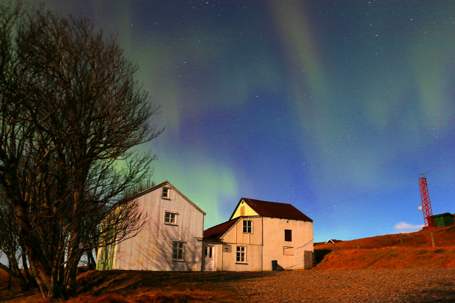 Northern lights dancing above the hostel