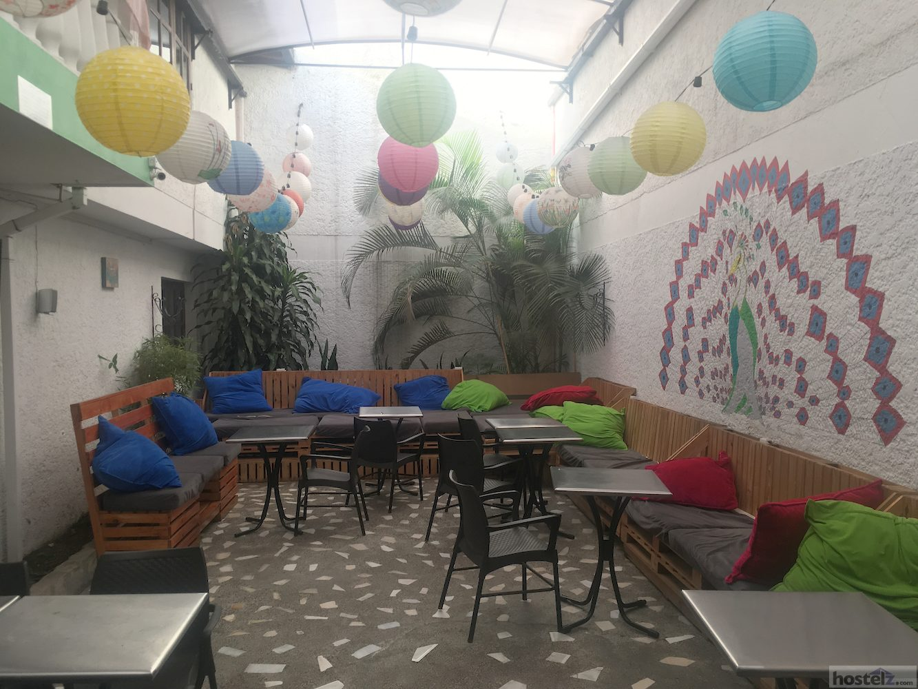 Colourful common area with seating, WiFi, TV and tea/coffee facilities