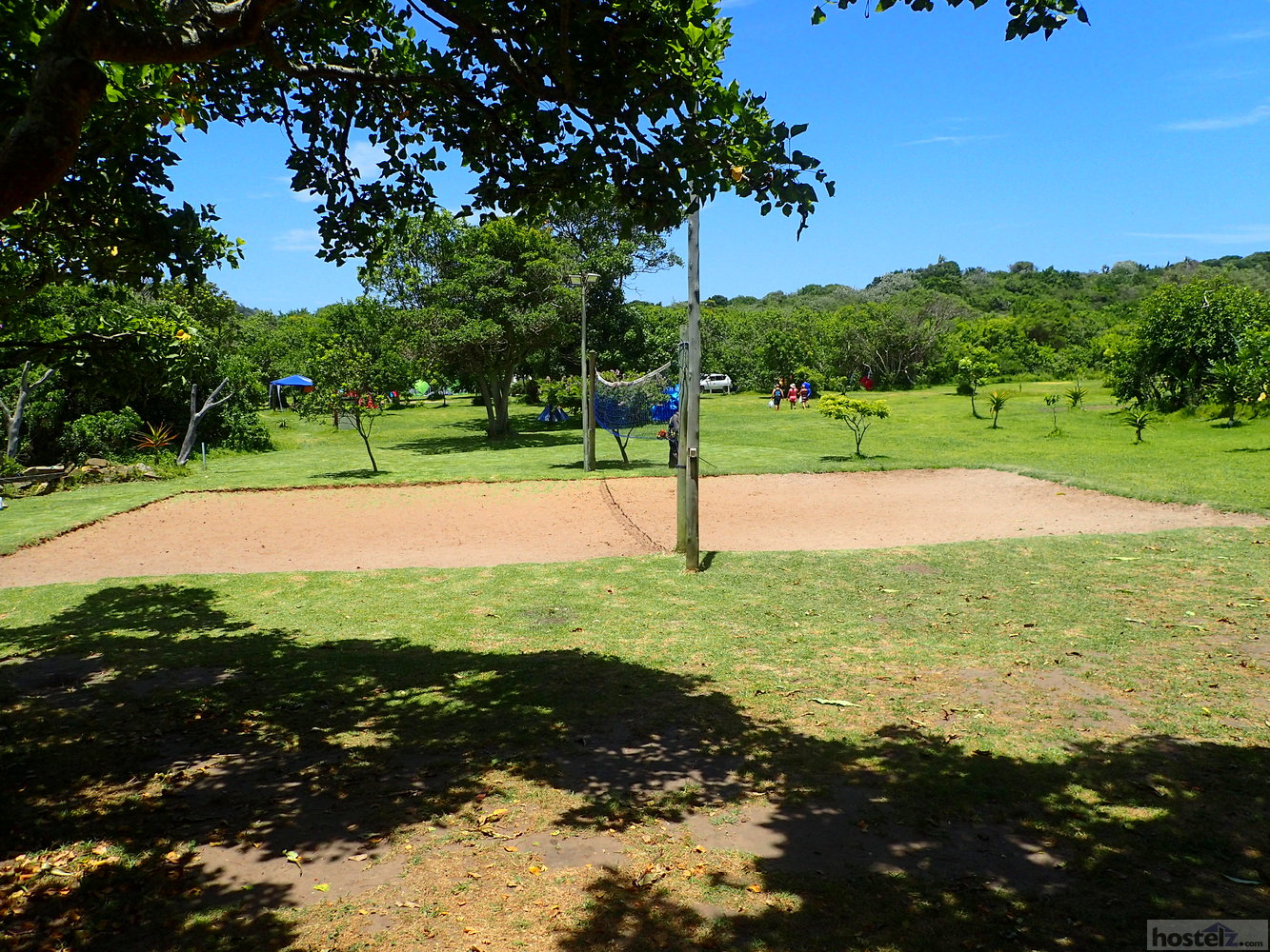 volleyball court with campground in background