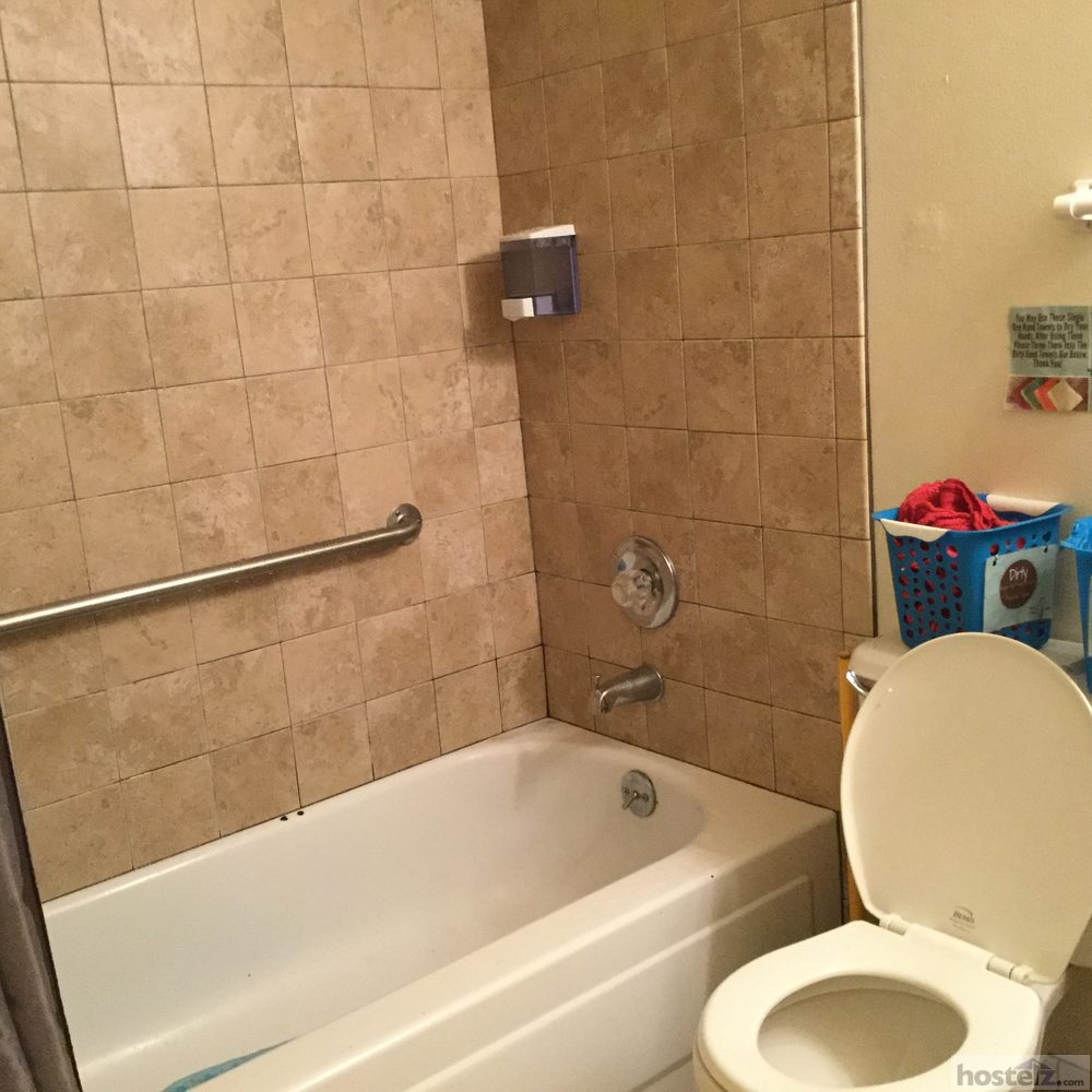 Full bathroom downstairs with shower