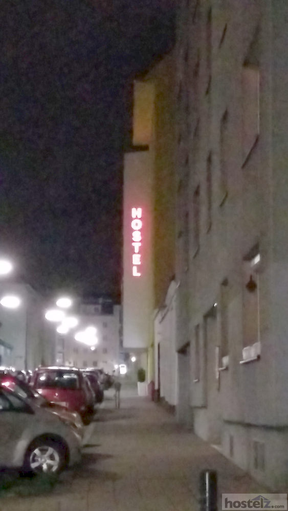 Brightly lit hostel sign